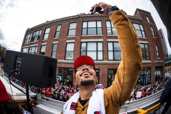 BOSTON, MA - OCTOBER 31: Mookie Betts #50 of the Boston Red Sox poses for a selfie photograph with fans as he rides on a duck boat during the 2018 World Series rolling rally parade on October 31, 2018 in Boston, Massachusetts. (Photo by Billie Weiss/Boston Red Sox/Getty Images) *** Local Caption *** Mookie Betts