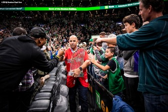 BOSTON, MA - NOVEMBER 1: Manager Alex Cora of the Boston Red Sox high fives fans as he holds the 2018 World Series trophy during a Boston Celtics game on November 1, 2018 at TD Garden in Boston, Massachusetts. (Photo by Billie Weiss/Boston Red Sox/Getty Images) *** Local Caption *** Alex Cora