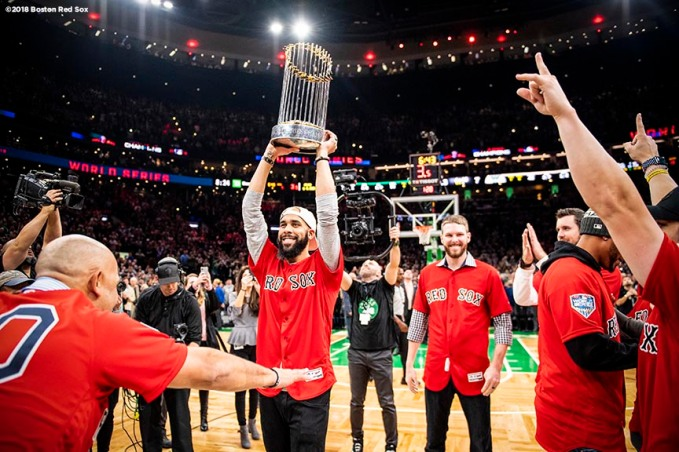 BOSTON, MA - NOVEMBER 1: David Price #24 of the Boston Red Sox displays the 2018 World Series trophy during a Boston Celtics game on November 1, 2018 at TD Garden in Boston, Massachusetts. (Photo by Billie Weiss/Boston Red Sox/Getty Images) *** Local Caption *** David Price