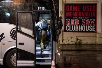 BOSTON, MA - NOVEMBER 3: Manager Alex Cora of the Boston Red Sox boards the bus from Fenway Park during a trip from Boston, Massachusetts to Caguas, Puerto Rico on November 3, 2018 after the Boston Red Sox 2018 World Series victory. (Photo by Billie Weiss/Boston Red Sox/Getty Images) *** Local Caption *** Alex Cora