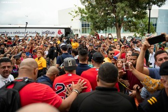 CAGUAS, PUERTO RICO - NOVEMBER 3: Manager Alex Cora of the Boston Red Sox is escorted to the bus among fans during a trip from Boston, Massachusetts to Caguas, Puerto Rico on November 3, 2018 after the Boston Red Sox 2018 World Series victory. (Photo by Billie Weiss/Boston Red Sox/Getty Images) *** Local Caption *** Alex Cora