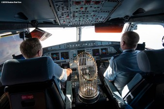 CAGUAS, PUERTO RICO - NOVEMBER 3: Pilots fly the plane as the World Series trophy sits in the cockpit during a Boston Red Sox trip from Boston, Massachusetts to Caguas, Puerto Rico on November 3, 2018 after the Boston Red Sox 2018 World Series victory. (Photo by Billie Weiss/Boston Red Sox/Getty Images) *** Local Caption ***