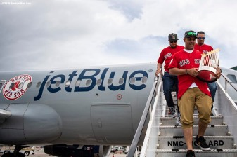 CAGUAS, PUERTO RICO - NOVEMBER 3: Manager Alex Cora, Christian Vazquez #7, and coach Ramon Vazquez of the Boston Red Sox exit the plane with the 2018 World Series trophy during a trip from Boston, Massachusetts to Caguas, Puerto Rico on November 3, 2018 after the Boston Red Sox 2018 World Series victory. (Photo by Billie Weiss/Boston Red Sox/Getty Images) *** Local Caption *** Alex Cora; Christian Vazquez; Ramon Vazquez
