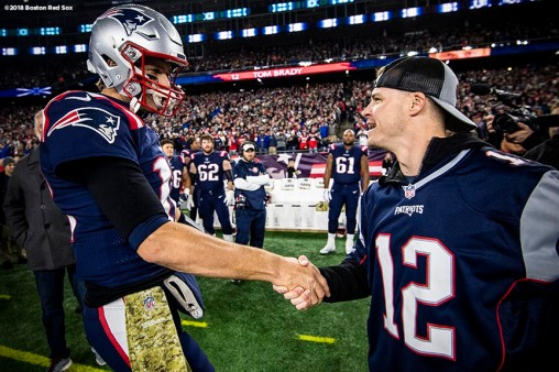 FOXBOROUGH, MA - NOVEMBER 4: Brock Holt #12 of the Boston Red Sox shakes hands with Tom Brady #12 of the New England Patriots before a game against the Green Bay Packers on November 4, 2018 at Gillette Stadium in Foxborough, Massachusetts. (Photo by Billie Weiss/Boston Red Sox/Getty Images) *** Local Caption *** Brock Holt; Tom Brady