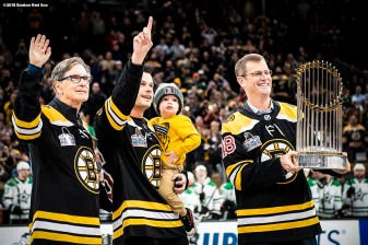 BOSTON, MA - NOVEMBER 5: Principal Owner John Henry, Joe Kelly #56 and his son Knox, and President & CEO Sam Kennedy of the Boston Red Sox participate in a ceremonial puck drop before a Boston Bruins game on November 5, 2018 at TD Garden in Boston, Massachusetts. (Photo by Billie Weiss/Boston Red Sox/Getty Images) *** Local Caption *** Joe Kelly; Sam Kennedy; John Henry