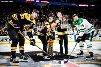 BOSTON, MA - NOVEMBER 5: Principal Owner John Henry, Joe Kelly #56 and his son Knox, and President & CEO Sam Kennedy of the Boston Red Sox participate in a ceremonial puck drop with Zdeno Chara #33 of the Boston Bruins and Jamie Benn #14 of the Dallas Stars before a Boston Bruins game on November 5, 2018 at TD Garden in Boston, Massachusetts. (Photo by Billie Weiss/Boston Red Sox/Getty Images) *** Local Caption *** Joe Kelly; Sam Kennedy; John Henry; Zdeno Chara; Jamie Benn