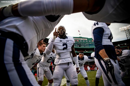 BOSTON, MA - NOVEMBER 17: Marquise Peggs #2 of the Yale Bulldogs reacts with teammates in the huddle before a game against the Harvard Crimson on November 17, 2018 at Fenway Park in Boston, Massachusetts. (Photo by Billie Weiss/Boston Red Sox/Getty Images) *** Local Caption *** Marquise Peggs