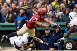 BOSTON, MA - NOVEMBER 17: Henry Taylor #28 of the Harvard Crimson scores a touchdown while being tackled by Noah Pope #30 of the Yale Bulldogs in the second quarter of a game at Fenway Park on November 17, 2018 in Boston, Massachusetts. (Photo by Billie Weiss/Boston Red Sox/Getty Images) *** Local Caption *** Henry Taylor; Noah Pope