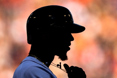 BOSTON, MA - SEPTEMBER 15: Mookie Betts #50 of the Boston Red Sox pulls on his necklace during the first inning of a game against the New York Mets on September 15, 2018 at Fenway Park in Boston, Massachusetts. (Photo by Billie Weiss/Boston Red Sox/Getty Images) *** Local Caption *** Mookie Betts