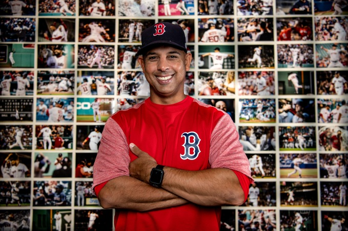 BOSTON, MA - OCTOBER 2: Manager Alex Cora of the Boston Red Sox poses for a portrait in front of a wall of photographs depicting every win throughout the season in his office during a workout before the American League Division Series on October 2, 2018 at Fenway Park in Boston, Massachusetts. (Photo by Billie Weiss/Boston Red Sox/Getty Images) *** Local Caption *** Alex Cora