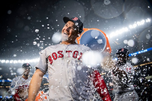 NEW YORK, NY - OCTOBER 8: Brock Holt #12 of the Boston Red Sox is doused with Gatorade after hitting for the cycle after game three of the American League Division Series against the New York Yankees on October 8, 2018 at Yankee Stadium in the Bronx borough of New York City. (Photo by Billie Weiss/Boston Red Sox/Getty Images) *** Local Caption *** Brock Holt