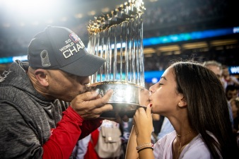 LOS ANGELES, CA - OCTOBER 28: Manager Alex Cora of the Boston Red Sox and his daughter Camila celebrate with the World Series trophy after winning the 2018 World Series in game five against the Los Angeles Dodgers on October 28, 2018 at Dodger Stadium in Los Angeles, California. (Photo by Billie Weiss/Boston Red Sox/Getty Images) *** Local Caption *** Camila Cora; Alex Cora