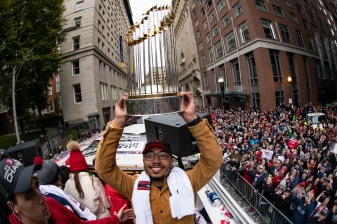 BOSTON, MA - OCTOBER 31: Mookie Betts #50 of the Boston Red Sox holds the World Series trophy as he rides on a duck boat during the 2018 World Series rolling rally parade on October 31, 2018 in Boston, Massachusetts. (Photo by Billie Weiss/Boston Red Sox/Getty Images) *** Local Caption *** Mookie Betts