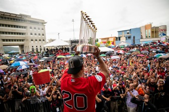CAGUAS, PUERTO RICO - NOVEMBER 3: Manager Alex Cora of the Boston Red Sox displays the 2018 World Series trophy during a World Series parade during a Boston Red Sox trip from Boston, Massachusetts to Caguas, Puerto Rico on November 3, 2018 after the Boston Red Sox 2018 World Series victory. (Photo by Billie Weiss/Boston Red Sox/Getty Images) *** Local Caption *** Alex Cora