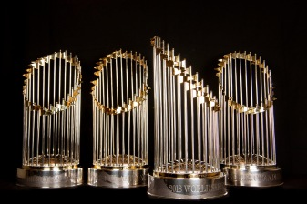 BOSTON, MA - NOVEMBER 26: The Boston Red Sox 2004, 2007, 2013, and 2018 World Series trophies are displayed on November 26, 2018 at Fenway Park in Boston, Massachusetts. (Photo by Billie Weiss/Boston Red Sox/Getty Images) *** Local Caption ***