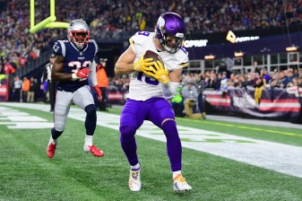 FOXBOROUGH, MA - DECEMBER 02: Adam Thielen #19 of the Minnesota Vikings scores a touchdown during the second quarter against the New England Patriots at Gillette Stadium on December 2, 2018 in Foxborough, Massachusetts. (Photo by Billie Weiss/Getty Images) *** Local Caption *** Adam Thielen