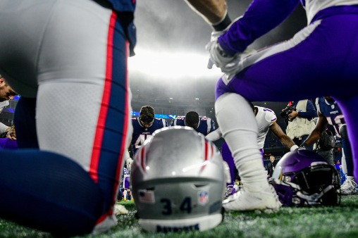 FOXBOROUGH, MA - DECEMBER 02: Members of the New England Patriots and Minnesota Vikings pray after a game at Gillette Stadium on December 2, 2018 in Foxborough, Massachusetts. (Photo by Billie Weiss/Getty Images)