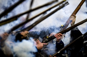 FOXBOROUGH, MA - DECEMBER 02: The end zone militia fire their muskets prior to the game between the Minnesota Vikings and the New England Patriots at Gillette Stadium on December 2, 2018 in Foxborough, Massachusetts. (Photo by Billie Weiss/Getty Images)