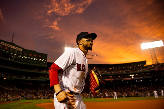 BOSTON, MA - JUNE 28: Mookie Betts #50 of the Boston Red Sox runs onto the field as the sun sets during the fifth inning of a game against the Los Angeles Angels of Anaheim on June 28, 2018 at Fenway Park in Boston, Massachusetts. (Photo by Billie Weiss/Boston Red Sox/Getty Images) *** Local Caption *** Mookie Betts