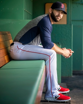 August 20, 2018, Boston, MA: Boston Red Sox first baseman Mitch Moreland poses for a portrait as he laces up his custom cleats for New Balance at Fenway Park in Boston, Massachusetts Monday, August 20, 2018. (Photo by Billie Weiss/Boston Red Sox)