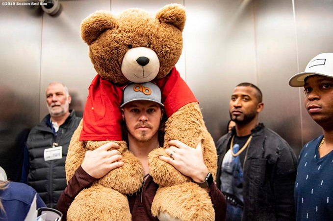 LEDYARD, CT - JANUARY 19: Brock Holt #12 of the Boston Red Sox carries a teddy bear during the 2019 Red Sox Winter Weekend on January 19, 2019 at Foxwoods Resort & Casino in Ledyard, Connecticut. (Photo by Billie Weiss/Boston Red Sox/Getty Images) *** Local Caption *** Brock Holt