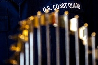 January 28, 2019 , Boston, MA: A member of the Coast Guard poses with the 2018 Boston Red Sox World Series trophy during an appreciation luncheon for close to 500 Massachusetts Coast Guard members and their families as a way to thank them for their service during the partial government shutdown at the Coast Guard Base in Boston, Massachusetts Monday, January 28, 2019. (Photo by Billie Weiss/Boston Red Sox)