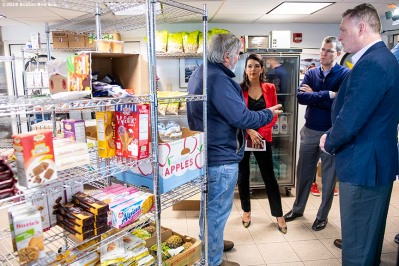 January 28, 2019 , Boston, MA: Red Sox Foundation Board Member Linda Henry, President & CEO Sam Kennedy, Brigadier General Jack Hammond, executive director of Home Base, and Boston Bruins Foundation Executive Director Bob Sweeney are given a tour of the food pantry during an appreciation luncheon for close to 500 Massachusetts Coast Guard members and their families as a way to thank them for their service during the partial government shutdown at the Coast Guard Base in Boston, Massachusetts Monday, January 28, 2019. (Photo by Billie Weiss/Boston Red Sox)