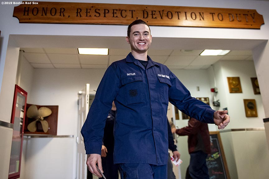 January 28, 2019 , Boston, MA: A member of the Coast Guard exits the function hall with a gift card during an appreciation luncheon for close to 500 Massachusetts Coast Guard members and their families as a way to thank them for their service during the partial government shutdown at the Coast Guard Base in Boston, Massachusetts Monday, January 28, 2019. (Photo by Billie Weiss/Boston Red Sox)