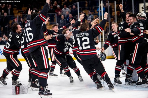 February 11, 2019, Boston, MA: Members of Northeastern University celebrate winning the 2019 Boston Beanpot Championship against Boston College at TD Garden in Boston, Massachusetts Monday, February 11, 2019. (Photo by Billie Weiss/Boston College)