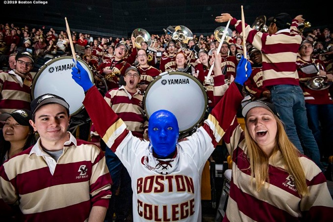 February 11, 2019, Boston, MA: Members of the Blue Man Group celebrate with fans of Boston College in the student section during the 2019 Boston Beanpot Championship against Northeastern University at TD Garden in Boston, Massachusetts Monday, February 11, 2019. (Photo by Billie Weiss/Boston College)