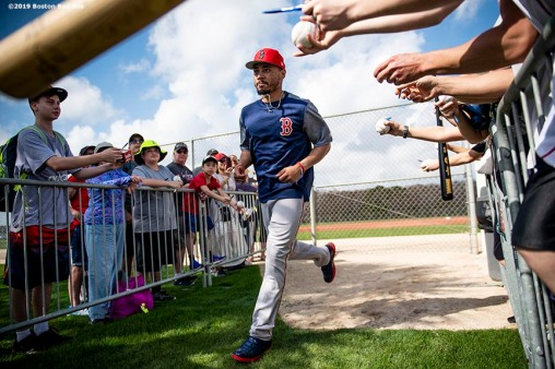 FT. MYERS, FL - FEBRUARY 18: Mookie Betts #50 of the Boston Red Sox jogs between fields as fans ask for autographs during a team workout on February 18, 2019 at JetBlue Park at Fenway South in Fort Myers, Florida. (Photo by Billie Weiss/Boston Red Sox/Getty Images) *** Local Caption *** Mookie Betts