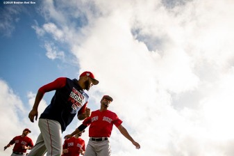 FT. MYERS, FL - FEBRUARY 20: Eduardo Rodriguez #52 and Xander Bogaerts #2 of the Boston Red Sox during a team workout on February 20, 2019 at JetBlue Park at Fenway South in Fort Myers, Florida. (Photo by Billie Weiss/Boston Red Sox/Getty Images) *** Local Caption *** Eduardo Rodriguez; Xander Bogaerts