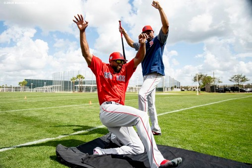FT. MYERS, FL - FEBRUARY 21: Eduardo Nunez #30 of the Boston Red Sox participates in a sliding drill as first base coach Tom Goodwin reacts during a team workout on February 21, 2019 at JetBlue Park at Fenway South in Fort Myers, Florida. (Photo by Billie Weiss/Boston Red Sox/Getty Images) *** Local Caption *** Eduardo Nunez; Tom Goodwin