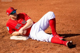 FT. MYERS, FL - FEBRUARY 23: Brock Holt #12 of the Boston Red Sox lies on a base before a game against the New York Yankees on February 23, 2019 at JetBlue Park at Fenway South in Fort Myers, Florida. (Photo by Billie Weiss/Boston Red Sox/Getty Images) *** Local Caption *** Brock Holt