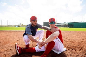 FT. MYERS, FL - FEBRUARY 23: Blake Swihart #23 of the Boston Red Sox reacts with Brock Holt #12 before a game against the New York Yankees on February 23, 2019 at JetBlue Park at Fenway South in Fort Myers, Florida. (Photo by Billie Weiss/Boston Red Sox/Getty Images) *** Local Caption *** Blake Swihart; Brock Holt