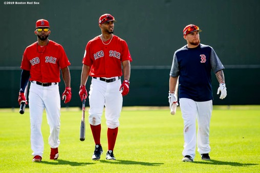 FT. MYERS, FL - FEBRUARY 23: Eduardo Nunez #36, Xander Bogaerts #2, and Christian Vazquez #7 of the Boston Red Sox walk onto the field before a game against the New York Yankees on February 23, 2019 at JetBlue Park at Fenway South in Fort Myers, Florida. (Photo by Billie Weiss/Boston Red Sox/Getty Images) *** Local Caption *** Eduardo Nunez; Xander Bogaerts; Christian Vazquez