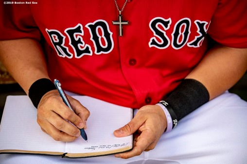 FT. MYERS, FL - FEBRUARY 23: Michael Chavis #65 of the Boston Red Sox writes in his notebook before a game against the New York Yankees on February 23, 2019 at JetBlue Park at Fenway South in Fort Myers, Florida. (Photo by Billie Weiss/Boston Red Sox/Getty Images) *** Local Caption *** Michael Chavis