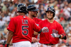 FT. MYERS, FL - FEBRUARY 23: Michael Chavis #65 of the Boston Red Sox reacts with Tzu-Wei Lin #5 and Bryce Brentz #54 after hitting a three run home run during the third inning of a game against the New York Yankees on February 23, 2019 at JetBlue Park at Fenway South in Fort Myers, Florida. (Photo by Billie Weiss/Boston Red Sox/Getty Images) *** Local Caption *** Michael Chavis; Bryce Brentz; Tzu-Wei Lin