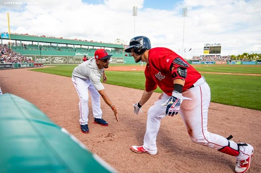 FT. MYERS, FL - FEBRUARY 23: Michael Chavis #65 of the Boston Red Sox reacts with Mookie Betts #50 after hitting a three run home run during the third inning of a game against the New York Yankees on February 23, 2019 at JetBlue Park at Fenway South in Fort Myers, Florida. (Photo by Billie Weiss/Boston Red Sox/Getty Images) *** Local Caption *** Michael Chavis; Mookie Betts