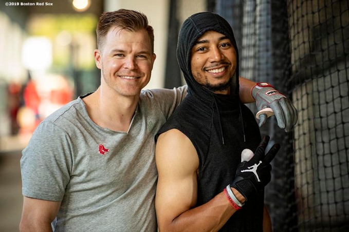 FT. MYERS, FL - FEBRUARY 25: Brock Holt #12 and Mookie Betts #50 of the Boston Red Sox pose for a photograph during a team workout on February 25, 2019 at JetBlue Park at Fenway South in Fort Myers, Florida. (Photo by Billie Weiss/Boston Red Sox/Getty Images) *** Local Caption *** Brock Holt; Mookie Betts