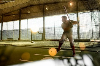 FT. MYERS, FL - FEBRUARY 25: Brock Holt #12 of the Boston Red Sox takes batting practice during a team workout on February 25, 2019 at JetBlue Park at Fenway South in Fort Myers, Florida. (Photo by Billie Weiss/Boston Red Sox/Getty Images) *** Local Caption *** Brock Holt