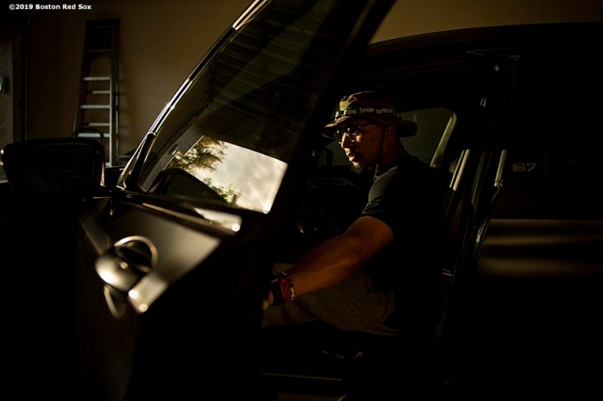 FT. MYERS, FL - FEBRUARY 28: Mookie Betts #50 of the Boston Red Sox rides into the ballpark before a game against the Washington Nationals on February 28, 2019 at JetBlue Park at Fenway South in Fort Myers, Florida. (Photo by Billie Weiss/Boston Red Sox/Getty Images) *** Local Caption *** Mookie Betts