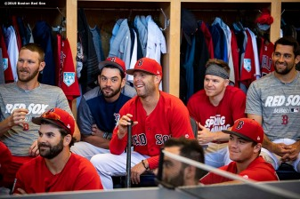 FT. MYERS, FL - FEBRUARY 28: Chris Sale #41, Blake Swihart #23, Dustin Pedroia #15, Brock Holt #12, and Nathan Eovaldi #17 of the Boston Red Sox react during a team meeting before a game against the Washington Nationals on February 28, 2019 at JetBlue Park at Fenway South in Fort Myers, Florida. (Photo by Billie Weiss/Boston Red Sox/Getty Images) *** Local Caption ***