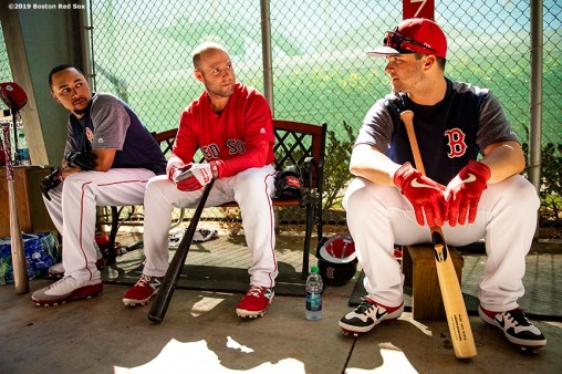FT. MYERS, FL - FEBRUARY 28: Mookie Betts #50, Dustin Pedroia #15, and Andrew Benintendi #16 of the Boston Red Sox react in the cage before a game against the Washington Nationals on February 28, 2019 at JetBlue Park at Fenway South in Fort Myers, Florida. (Photo by Billie Weiss/Boston Red Sox/Getty Images) *** Local Caption *** Mookie Betts; Dustin Pedroia; Andrew Benintendi