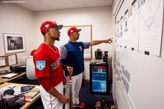 FT. MYERS, FL - FEBRUARY 28: Manager Alex Cora of the Boston Red Sox works in his office with Mookie Betts #50 before a game against the Washington Nationals on February 28, 2019 at JetBlue Park at Fenway South in Fort Myers, Florida. (Photo by Billie Weiss/Boston Red Sox/Getty Images) *** Local Caption *** Alex Cora; Mookie Betts