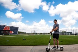 FT. MYERS, FL - MARCH 4: Brock Holt #12 of the Boston Red Sox rides a Bird scooter during a team workout on March 4, 2019 at JetBlue Park at Fenway South in Fort Myers, Florida. (Photo by Billie Weiss/Boston Red Sox/Getty Images) *** Local Caption *** Brock Holt