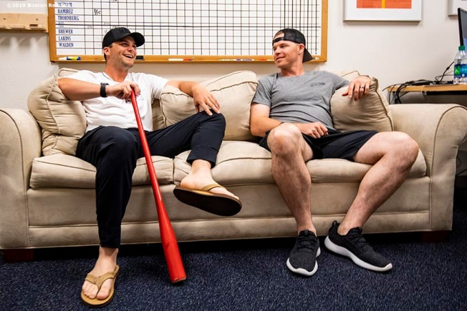 FT. MYERS, FL - MARCH 4: Andrew Benintendi #16 and Brock Holt #12 of the Boston Red Sox hang out on the couch in Manager Alex Cora's office during a team workout on March 4, 2019 at JetBlue Park at Fenway South in Fort Myers, Florida. (Photo by Billie Weiss/Boston Red Sox/Getty Images) *** Local Caption *** Andrew Benintendi; Brock Holt