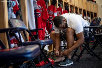 FT. MYERS, FL - MARCH 5: Eduardo Rodriguez #57 of the Boston Red Sox ties his shoes in the clubhouse before going fishing after a team workout on March 5, 2019 in Sanibel, Florida. (Photo by Billie Weiss/Boston Red Sox/Getty Images) *** Local Caption *** Eduardo Rodriguez