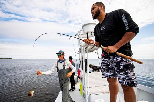 FT. MYERS, FL - MARCH 5: Eduardo Rodriguez #57 of the Boston Red Sox catches a fish during a fishing trip after a team workout on March 5, 2019 in Sanibel, Florida. (Photo by Billie Weiss/Boston Red Sox/Getty Images) *** Local Caption *** Eduardo Rodriguez