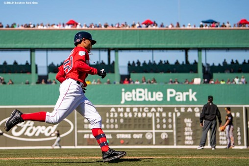 FT. MYERS, FL - MARCH 6: Mookie Betts #50 of the Boston Red Sox rounds first base after hitting a single during the fourth inning of a game against the Pittsburgh Pirates on March 6, 2019 at JetBlue Park at Fenway South in Fort Myers, Florida. (Photo by Billie Weiss/Boston Red Sox/Getty Images) *** Local Caption *** Mookie Betts